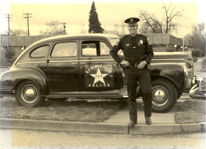 Lt. Chris Mahulka beside Springfield police car. Probably taken after 1957.